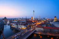 Germany, Berlin, panoramic view with television tower, Red City Hall and St. Nicholas church at sunset - PUF01414