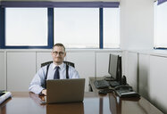 Portrait of confident businessman at desk in office - AHSF00225