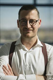 Portrait of confident businessman in sunlight - AHSF00255
