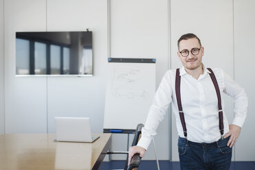 Portrait of confident businessman in conference room in office - AHSF00270