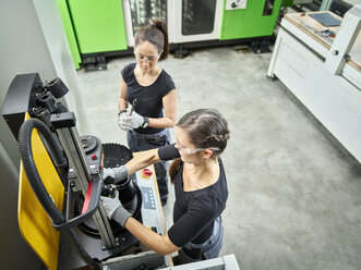 Two women working on a machine - CVF01142