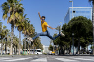 Spain, Barcelona, man in the city jumping on the street - AFVF02883