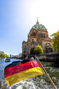 Germany, Berlin, Berlin Cathedral and German flag on excursion boat on River Spree - PUF01416