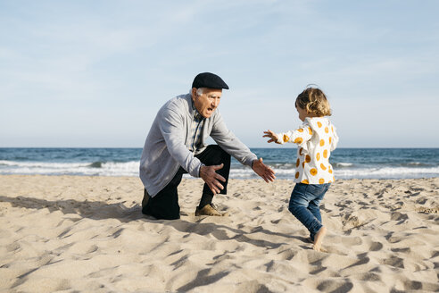 Grandfather playing with his little granddaughter on the beach - JRFF03213