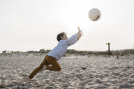 Little boy playing soccer on the beach - JRFF03234