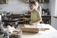 Little girl preparing stuffed pastry in the kitchen - KMKF00912