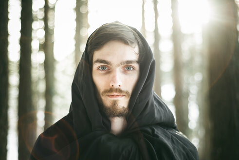 Caucasian man with beard wearing robe in forest - BLEF02074