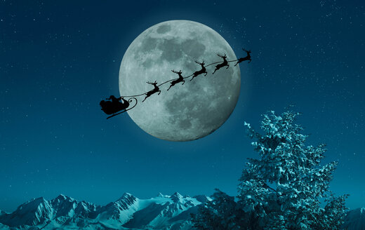 Silhouette of Santa and reindeer flying sleigh near full moon - BLEF02107