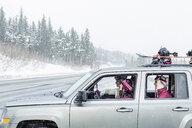 Friends driving in car in winter - BLEF02167