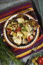 Casserole with aubergines, tomatoes, potatoes and green olives garnished with dill - MAEF12862