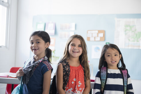 Portrait of girls smiling in classroom - BLEF02363