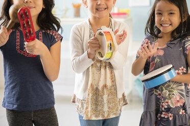 Girls playing music in school - BLEF02387