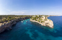 Spain, Balearic Islands, Mallorca, Llucmajor, Aerial view of bay of Cala Pi and Torre de Cala Pi - AMF06983