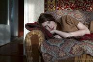 Caucasian woman laying on sofa - BLEF02611