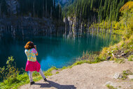 Caucasian woman photographing trees in lake - BLEF02683