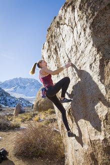 Caucasian teenage girl climbing rock - BLEF02728