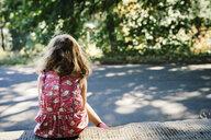 Caucasian girl sitting on curb - BLEF02875