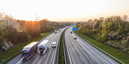 Germany, Baden-Wuerttemberg, traffic on Autobahn A8 at sunset - WDF05258