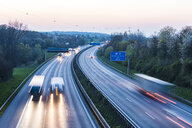 Germany, Baden-Wuerttemberg, traffic on Autobahn A8 at sunset - WDF05261