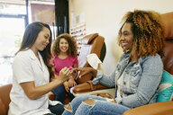 Business owner assisting customer in nail salon - BLEF02933