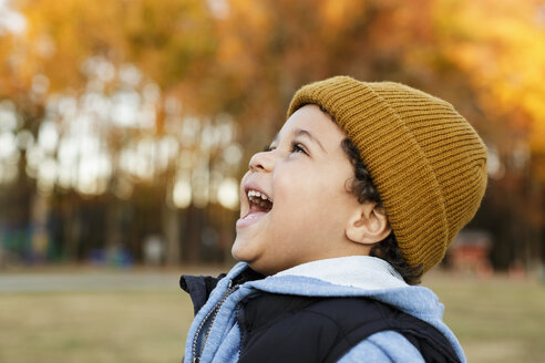 Mixed Race boy laughing in park - BLEF02945
