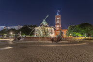 Germany, Berlin, view to lighted Red City Hall and Neptune fountain at night - TAMF01380