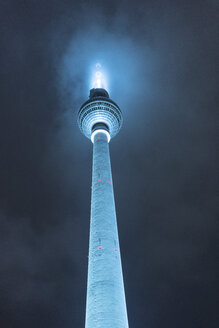Germany, Berlin, illuminated television tower at night - TAMF01404