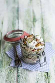 Glass of fried potato salad with cucumber, red radish, spring onions and mayonnaise yoghurt dressing - STBF00314