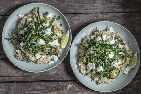 Two plates of lemon risotto with Buffalo Mozzarella, rocket, baked courgette and pine nuts - STBF00317