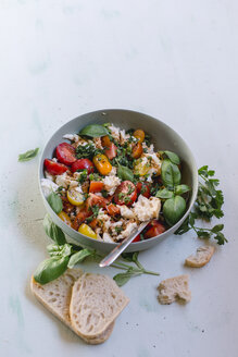 Bowl of mozzarella, tomatoes and basil with balsamico vinegar, olive oil and ciabatta - STBF00338