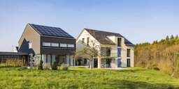 Germany, Nuertingen, modern one-family houses with solar roof - WDF05264