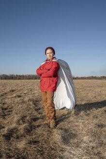Boy dressed up as superhero posing in steppe landscape - VPIF01230
