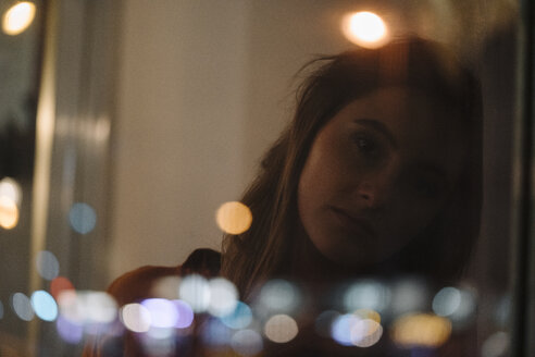 Portrait of serious young woman behind windowpane - KNSF05764