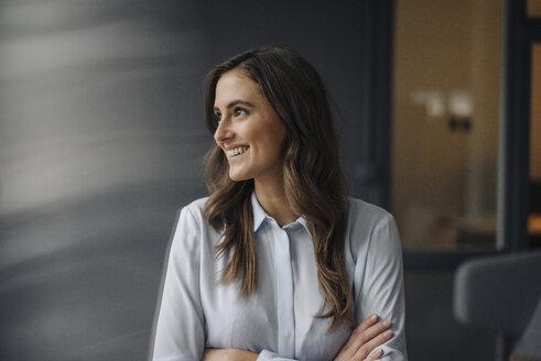 Portrait of happy young businesswoman looking sideways - KNSF05788