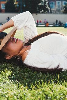 Woman lying down on grass - CUF50631