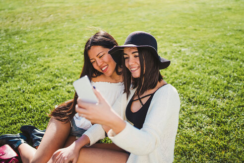 Friends taking selfie on field - CUF50634