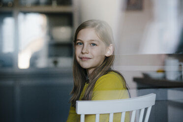 Portrait of a girl sitting on chair at home - KNSF05860