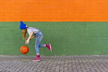 Young girl playing basketball, dribbling - ERRF01235