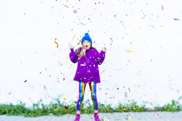 Girl wearing colorful clothing, confetti in front - ERRF01268