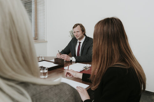Business people having a meeting in conference room - AHSF00312