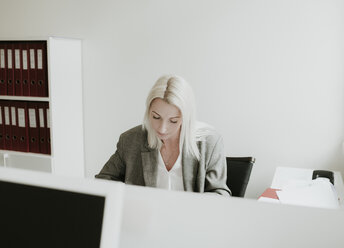 Young woman working at desk in office - AHSF00330