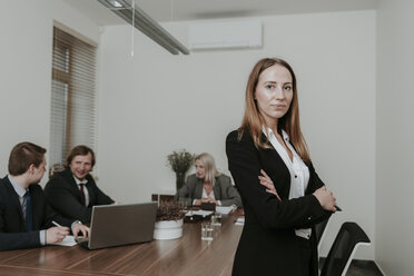 Portrait of confident young businesswoman on a meeting in conference room - AHSF00348