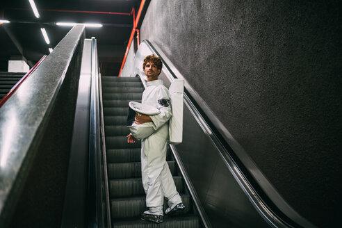 Astronaut going up escalator - CUF50680