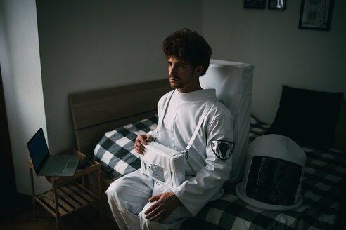 Astronaut daydreaming on bed - CUF50692