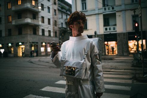 Astronaut using smartphone on pedestrian crossing - CUF50707