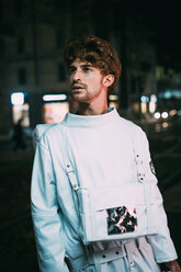 Astronaut in city at night - CUF50716