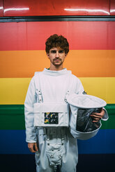 Astronaut standing against coloured wall - CUF50722