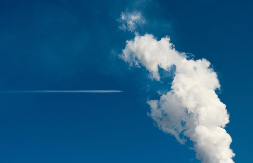 Smoke leaving chimney, contrail of passing plane - CUF50848