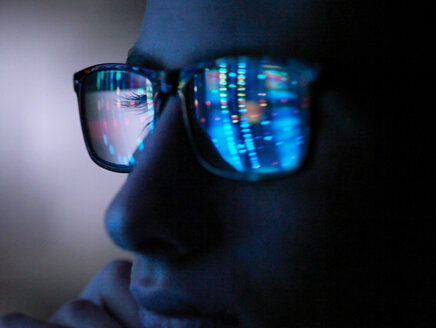 Genetic research, computer screen reflection in spectacles of DNA profile, close up of face - CUF51007