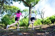 Girlfriends running in forest, Tunbridge Wells, Kent, United Kingdom - CUF51037